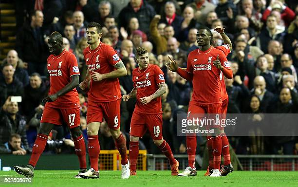 Christian Benteke of Liverpool celebrates scoring his side's first goal during the Barclays Premier League match between Liverpool and Leicester City...