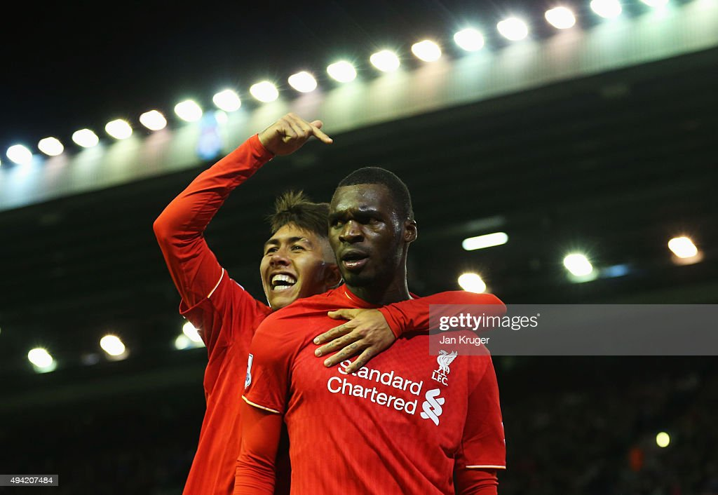<a gi-track='captionPersonalityLinkClicked' href=/galleries/search?phrase=Christian+Benteke&family=editorial&specificpeople=4282509 ng-click='$event.stopPropagation()'>Christian Benteke</a> (R) of Liverpool celebrates scoring his team's first goal with his team mate <a gi-track='captionPersonalityLinkClicked' href=/galleries/search?phrase=Roberto+Firmino&family=editorial&specificpeople=7522629 ng-click='$event.stopPropagation()'>Roberto Firmino</a> (L) during the Barclays Premier League match between Liverpool and Southampton at Anfield on October 25, 2015 in Liverpool, England.