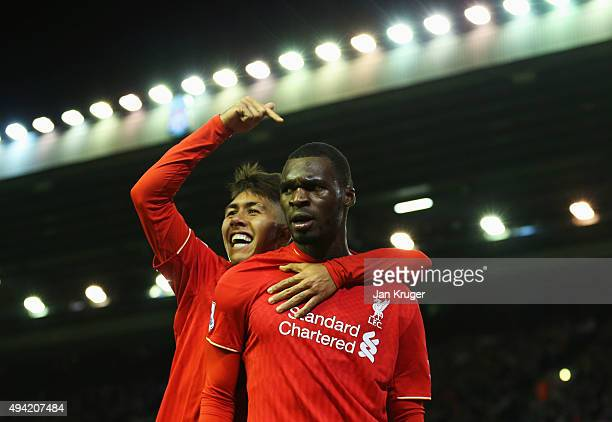 Christian Benteke of Liverpool celebrates scoring his team's first goal with his team mate Roberto Firmino during the Barclays Premier League match...