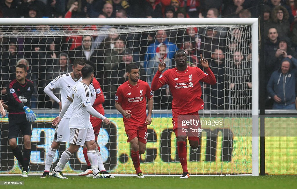 <a gi-track='captionPersonalityLinkClicked' href=/galleries/search?phrase=Christian+Benteke&family=editorial&specificpeople=4282509 ng-click='$event.stopPropagation()'>Christian Benteke</a> of Liverpool celebrates scoring his team's opening goal during the Barclays Premier League match between Swansea City and Liverpool at The Liberty Stadium on May 1, 2016 in Swansea, Wales.
