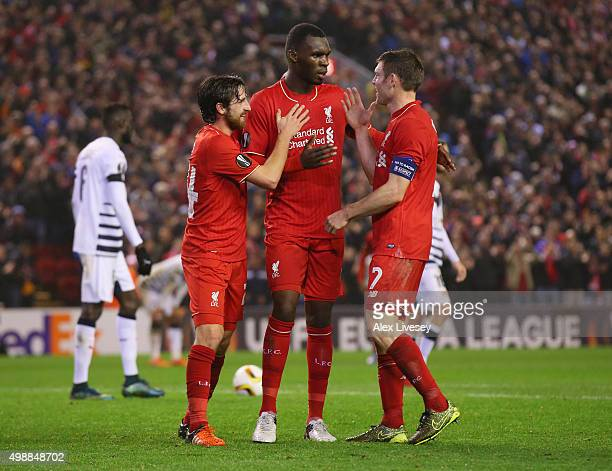 Christian Benteke of Liverpool celebrates with Joe Allen and James Milner as he scores their second goal during the UEFA Europa League Group B match...