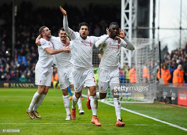 Christian Benteke of Liverpool celebrates with team mates as he scores their second goal from the penalty spot during the Barclays Premier League...