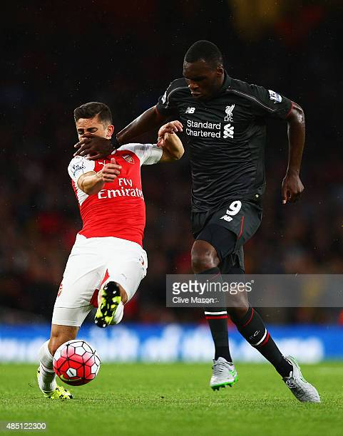 Christian Benteke of Liverpool hands off Gabriel Paulista of Arsenal during the Barclays Premier League match between Arsenal and Liverpool at...