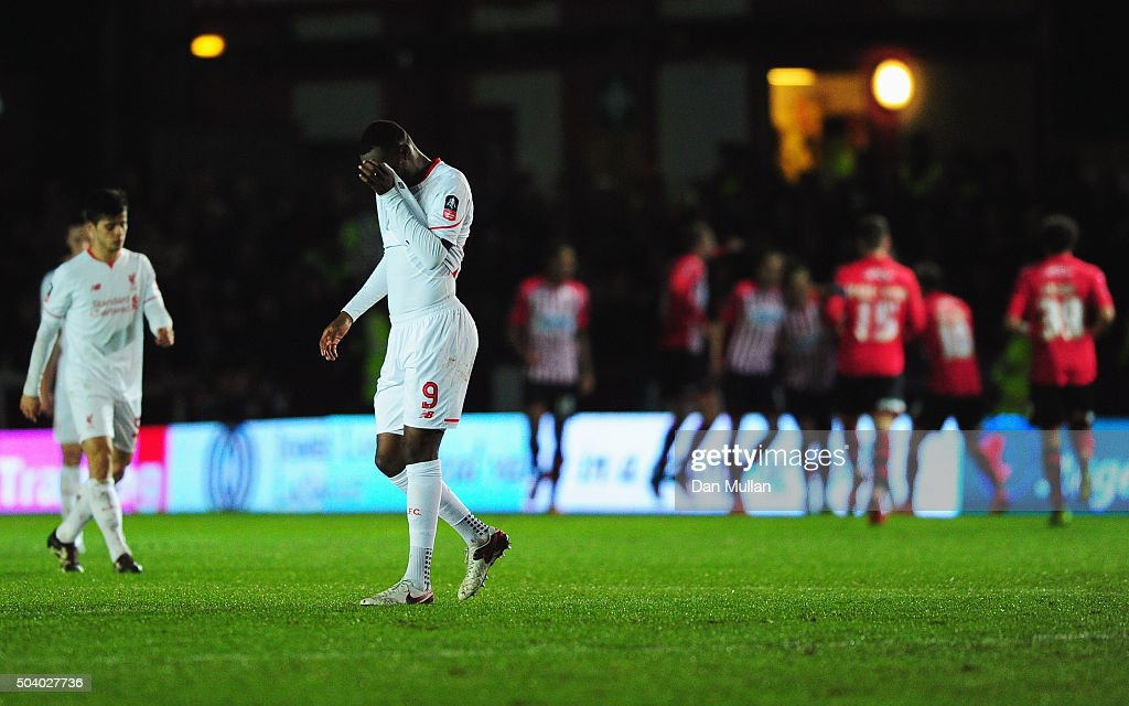 <a gi-track='captionPersonalityLinkClicked' href=/galleries/search?phrase=Christian+Benteke&family=editorial&specificpeople=4282509 ng-click='$event.stopPropagation()'>Christian Benteke</a> of Liverpool (9) reacts as Tom Nichols of Exeter City scores the opening goal during the Emirates FA Cup third round match between Exeter City and Liverpool at St James Park on January 8, 2016 in Exeter, England.