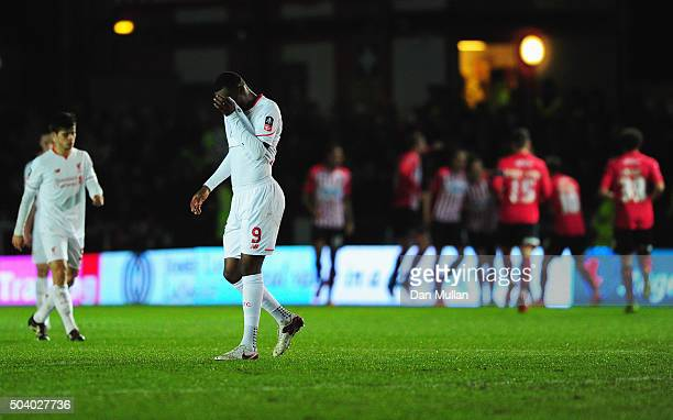 Christian Benteke of Liverpool reacts as Tom Nichols of Exeter City scores the opening goal during the Emirates FA Cup third round match between...