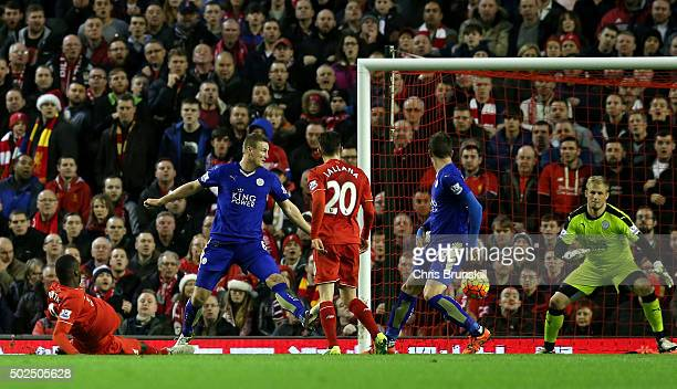 Christian Benteke of Liverpool scores his side's first goal past Kasper Schmeichel of Leicester City during the Barclays Premier League match between...