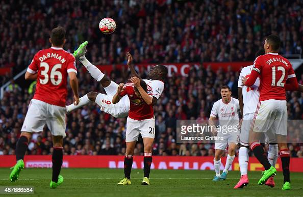 Christian Benteke of Liverpool scores with an overhead kick during the Barclays Premier League match between Manchester United and Liverpool at Old...