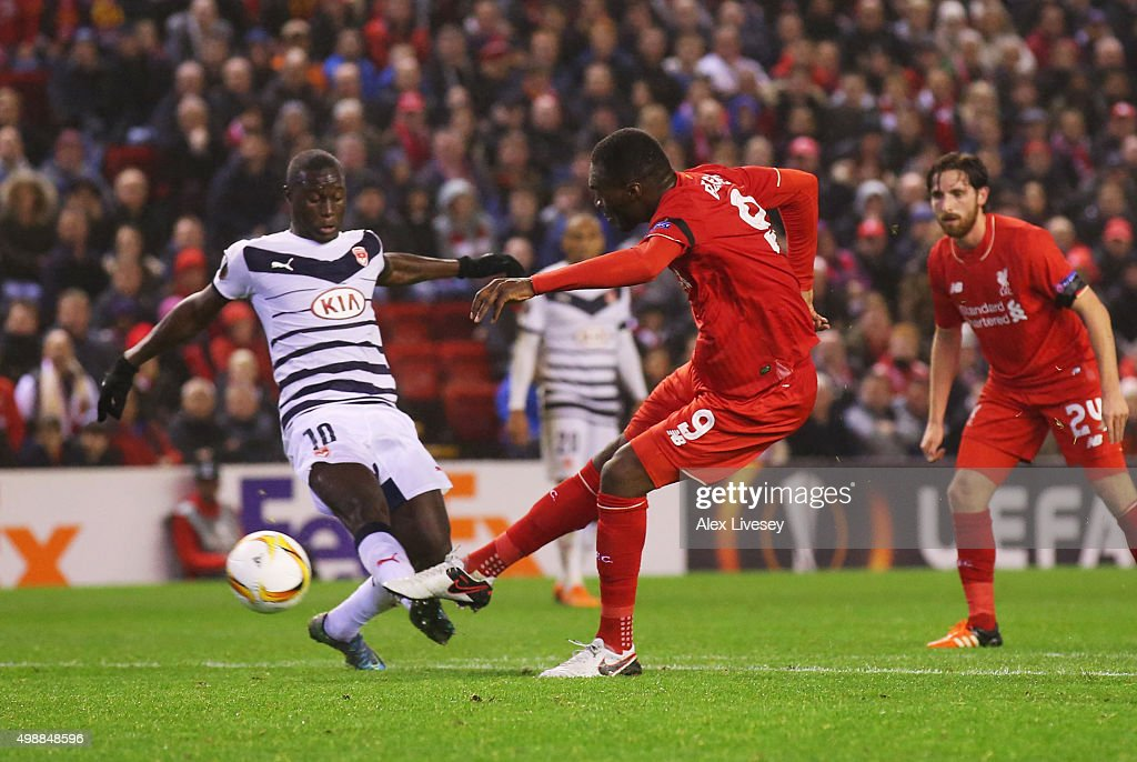 <a gi-track='captionPersonalityLinkClicked' href=/galleries/search?phrase=Christian+Benteke&family=editorial&specificpeople=4282509 ng-click='$event.stopPropagation()'>Christian Benteke</a> of Liverpool shoots past <a gi-track='captionPersonalityLinkClicked' href=/galleries/search?phrase=Henri+Saivet&family=editorial&specificpeople=5969966 ng-click='$event.stopPropagation()'>Henri Saivet</a> of Bordeaux as he scores their second goal during the UEFA Europa League Group B match between Liverpool FC and FC Girondins de Bordeaux at Anfield on November 26, 2015 in Liverpool, United Kingdom.