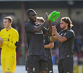 Christian Benteke of Liverpool shows his appreciation to the fans at the end of a preseason friendly at County Ground on August 2 2015 in Swindon...