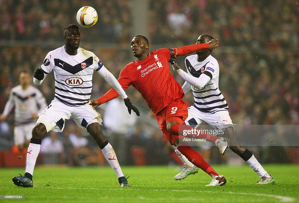 <a gi-track='captionPersonalityLinkClicked' href=/galleries/search?phrase=Christian+Benteke&family=editorial&specificpeople=4282509 ng-click='$event.stopPropagation()'>Christian Benteke</a> of Liverpool takes on Ludovic Sane of Bordeaux (L) during the UEFA Europa League Group B match between Liverpool FC and FC Girondins de Bordeaux at Anfield on November 26, 2015 in Liverpool, United Kingdom.