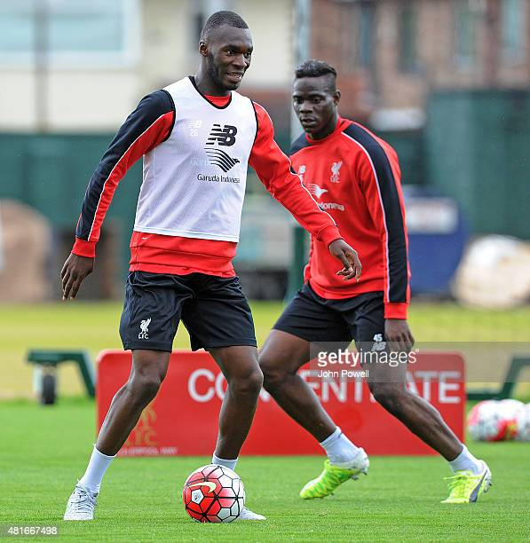 Christian Benteke of Liverpool trains on his first day with the club alongside Mario Balotelli at Melwood Training Ground on July 23 2015 in...
