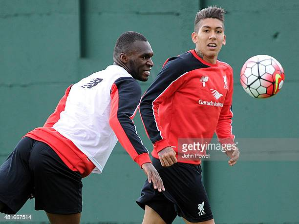 Christian Benteke of Liverpool trains on his first day with the club alongside Roberto Firmino at Melwood Training Ground on July 23 2015 in...