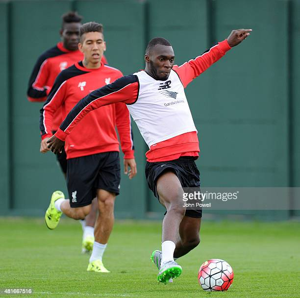 Christian Benteke of Liverpool trains on his first day with the club alongside Mario Balotelli and Roberto Firmino at Melwood Training Ground on July...