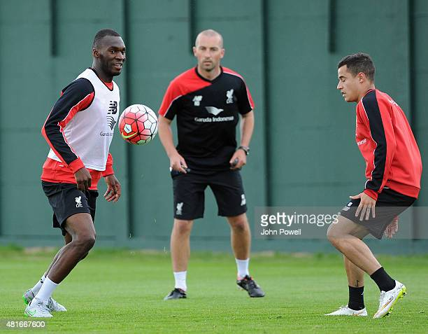 Christian Benteke of Liverpool trains on his first day with the club alongside Philippe Coutinho at Melwood Training Ground on July 23 2015 in...