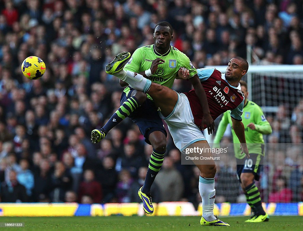 <a gi-track='captionPersonalityLinkClicked' href=/galleries/search?phrase=Christian+Benteke&family=editorial&specificpeople=4282509 ng-click='$event.stopPropagation()'>Christian Benteke</a> of Villa can't hold off the challenge from <a gi-track='captionPersonalityLinkClicked' href=/galleries/search?phrase=Winston+Reid&family=editorial&specificpeople=5491819 ng-click='$event.stopPropagation()'>Winston Reid</a> of West Ham during the Barclays Premier League match between West Ham United and Aston Villa at Upton Park on November 02, 2013 in London, England.
