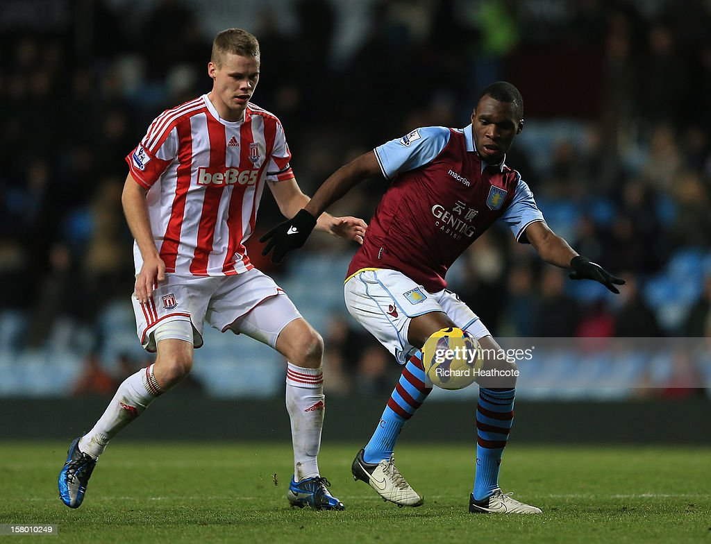 <a gi-track='captionPersonalityLinkClicked' href=/galleries/search?phrase=Christian+Benteke&family=editorial&specificpeople=4282509 ng-click='$event.stopPropagation()'>Christian Benteke</a> of Villa holds off <a gi-track='captionPersonalityLinkClicked' href=/galleries/search?phrase=Ryan+Shawcross&family=editorial&specificpeople=4443278 ng-click='$event.stopPropagation()'>Ryan Shawcross</a> of Stoke during the Barclays Premier League match between Aston Villa and Stoke City at Villa Park on December 8, 2012 in Birmingham, England.