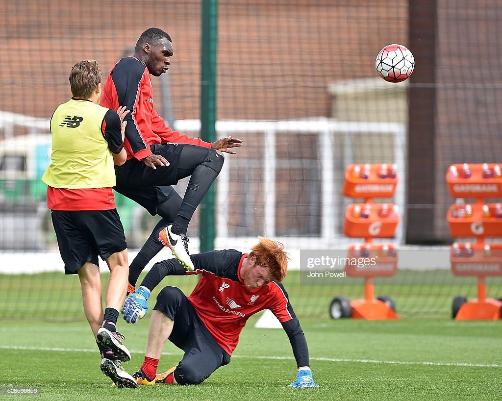Christian Benteke with Adam Bogdan of Liverpool during a training session at Melwood Training Ground on May 6, 2016 in Liverpool, England.