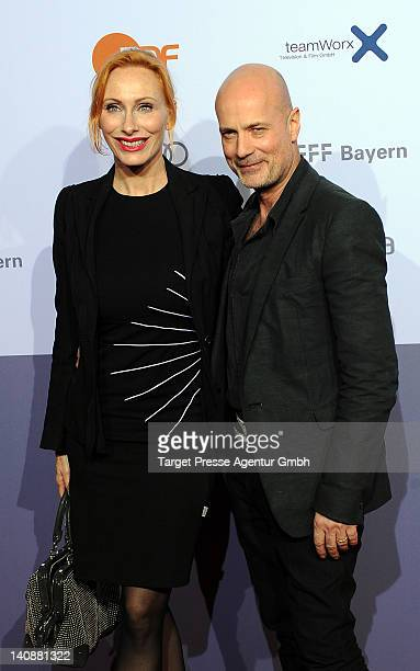 Christian Berkel and his wife Andrea Sawatzki attend the premiere of 'Muenchen 72 Das Attentat' at Astor Film Lounge on March 7 2012 in Berlin Germany
