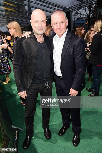 Christian Berkel and Joachim Krol attend the 'The Jungle Book' German Premiere on April 05 2016 in Berlin Germany