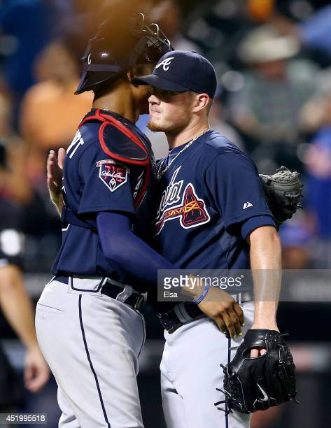 Christian Bethancourt and Craig Kimbrel of the Atlanta Braves celebrate the win over the New York Mets on July 10 2014 at Citi Field in the Flushing...