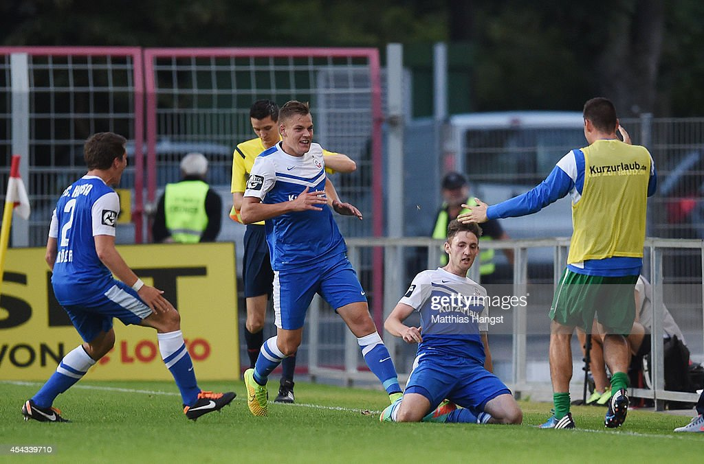 Christian Bickel (2 R) of Rostock celebrates with his team-mates after scoring his team's first goal during the Third league match between 1. FSV Mainz 05 II and Hansa Rostock at Bruchweg Stadium on August 29, 2014 in Mainz, Germany.