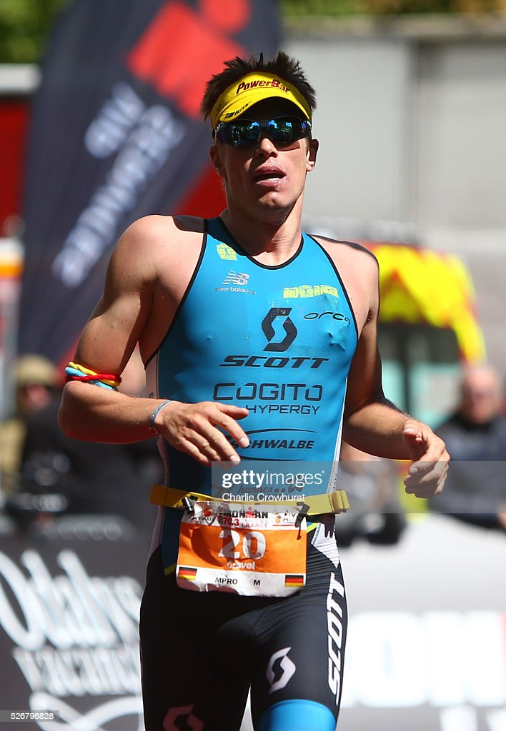 Christian Birngruber of Austria crosses the line to finish third in the mens race during Ironman 70.3 Aix en Provence on May 01, 2016 in Aix en Provence, France.
