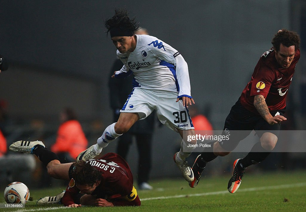 Christian Bolanos of Kobenhavn and Christian Schulz and Emanuel Pogatetz of Hannover battle for the ball during the UEFA Europa League Group B match...