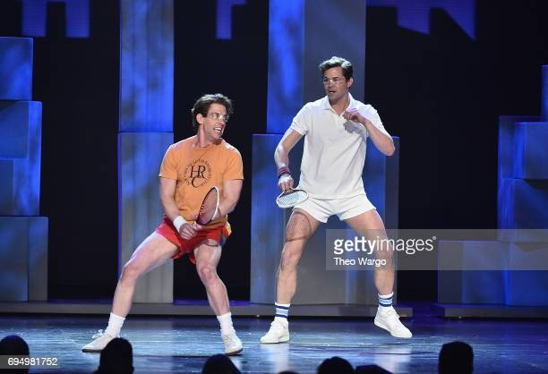 Christian Borle and Andrew Rannells perform with the cast of 'Falsettos' onstage during the 2017 Tony Awards at Radio City Music Hall on June 11 2017...