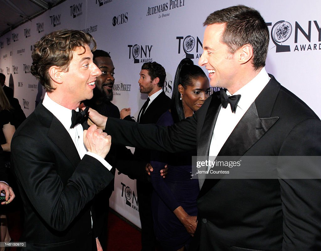 Christian Borle and Hugh Jackman attend the 66th Annual Tony Awards at The Beacon Theatre on June 10, 2012 in New York City.