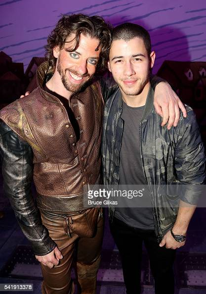 Christian Borle and Nick Jonas pose backstage at the hit musical 'Something Rotten' on Broadway at The StJames Theatre on June 20 2016 in New York...