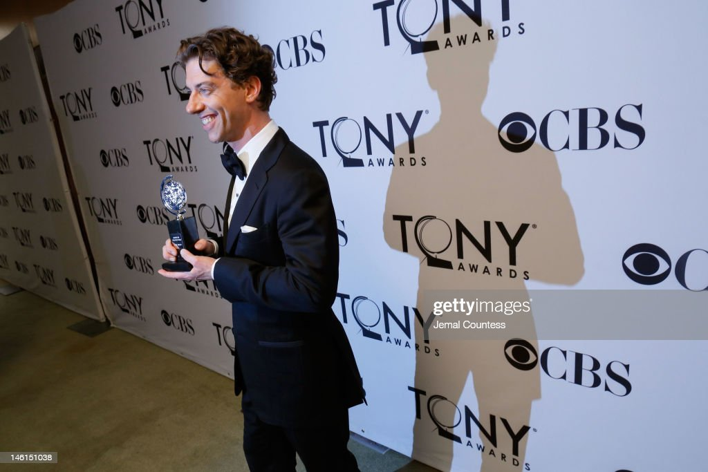 Christian Borle of Peter and the Starcatcher poses with his award for Best Performance by an Actor in a Featured Role in a Play during the 66th Annual Tony Awards press room at The Beacon Theatre on June 10, 2012 in New York City.
