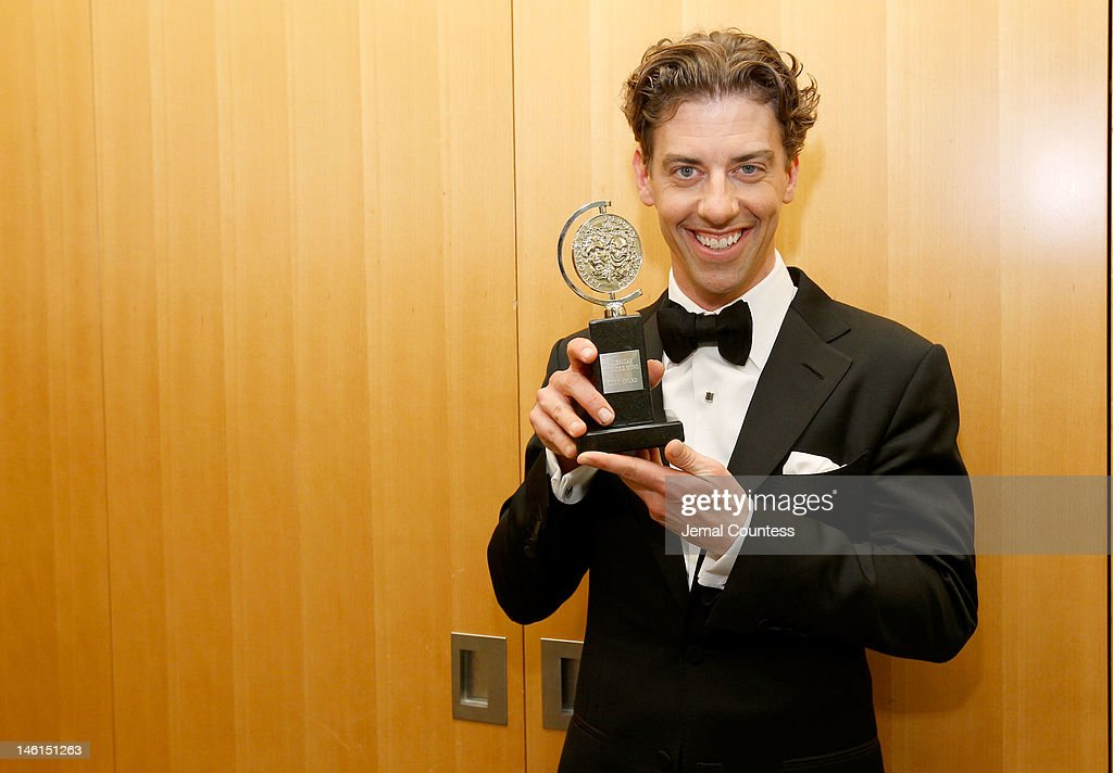 Christian Borle, winner for Featured Actor in a Play for 'Peter and the Starcatcher' poses in the 66th Annual Tony Awards press room at The Beacon Theatre on June 10, 2012 in New York City.