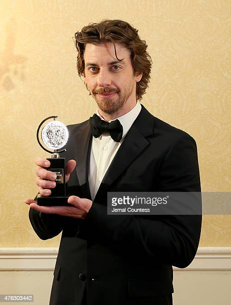 Christian Borle winner of the award for Best Performance by an Actor in a Featured Role in a Musical for 'Something Rotten' poses in the press room...