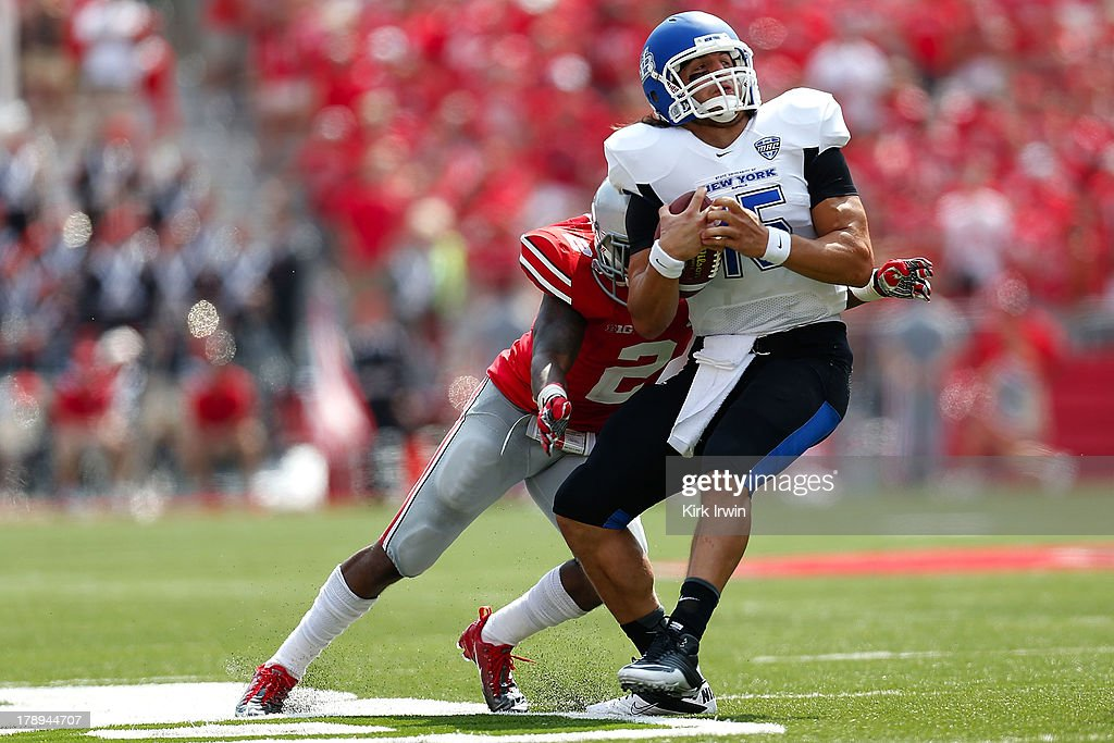 Christian Bryant #2 of the Ohio State Buckeyes tackles Alex Zordich #15 of the Buffalo Bulls during the fourth quarter on August 31, 2013 at Ohio Stadium in Columbus, Ohio. Ohio State defeated Buffalo 40-20.