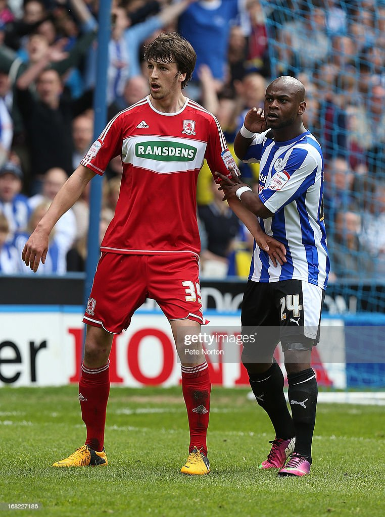 Christian Burgess of Middlesbrough with <a gi-track='captionPersonalityLinkClicked' href=/galleries/search?phrase=Leroy+Lita&family=editorial&specificpeople=661193 ng-click='$event.stopPropagation()'>Leroy Lita</a> #24 of Sheffield Wednesday in action during the npower Championship match between Sheffield Wednesday and Middlesbrough at Hillsborough Stadium on May 4, 2013 in Sheffield, England.