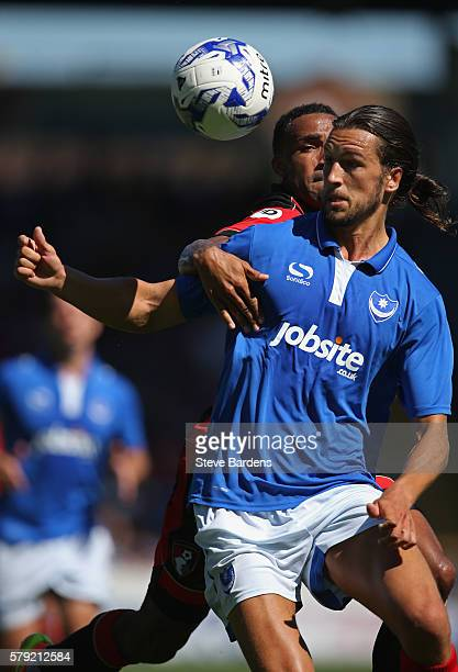 Christian Burgess of Portsmouth FC challenges for the ball with Callum Wilson of AFC Bournemouth during a PreSeason Friendly match between Portsmouth...