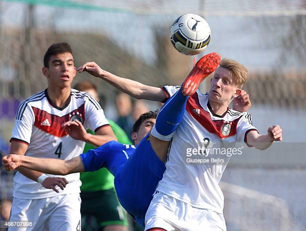Christian Capone of Italy and Nikki Beste of Germany in action during the international friendly match between U16 Italy and U16 Germany on March 18...