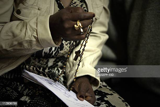 A Christian Catholic woman living in Libya attends Good Friday service at Saint Francis church ahead of Easter celebrations in central Tripoli on...