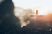 cross on blurry sunset background. Christian, Christianity, Religion copyspace background.