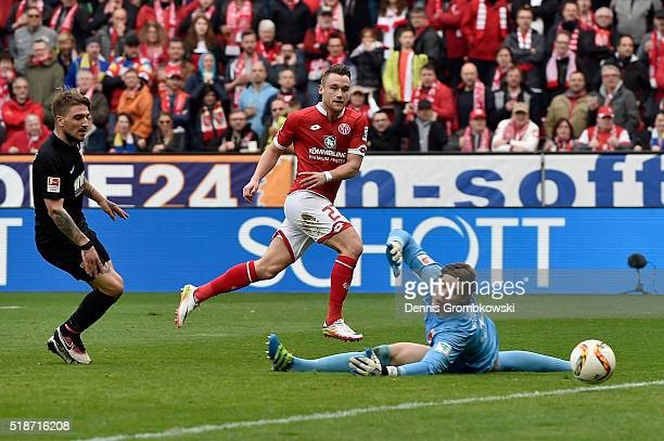 Christian Clemens of 1 FSV Mainz 05 scores their fourth goal past goalkeeper Marwin Hitz of FC Augsburg during the Bundesliga match between 1 FSV...