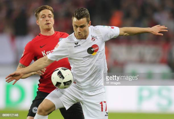 Christian Clemens of Cologne and Bastian Oczipka of Eintracht Frankfurt battle for the ball during the German Bundesliga soccer match between 1 FC...