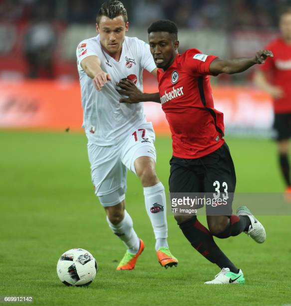 Christian Clemens of Cologne and Taleb Tawatha of Eintracht Frankfurt battle for the ball during the German Bundesliga soccer match between 1 FC...