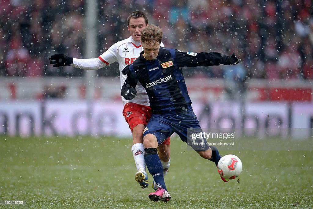 Christian Clemens of Cologne challenges Bjoern Jopek of Berlin during the Second Bundesliga match between 1. FC Koeln and Union Berlin at RheinEnergieStadion on February 23, 2013 in Cologne, Germany.