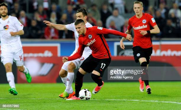 Christian Clemens of Cologne in action against Ante Rebicr of Frankfurt during the German Bundesliga soccer match between 1 FC Cologne and Eintracht...