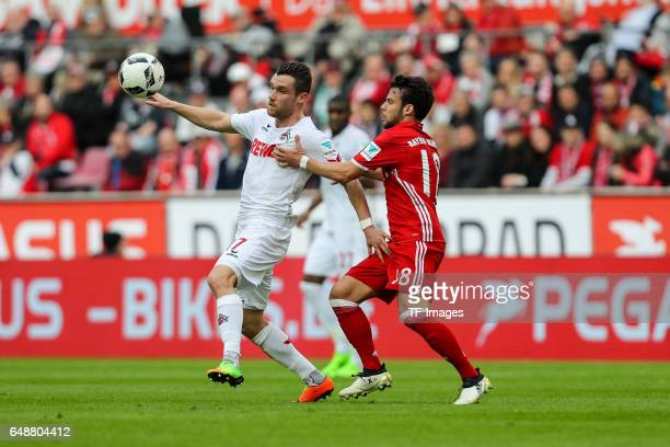 Christian Clemens of Cologne und Juan Bernat of Bayern Munich battle for the ball during the Bundesliga match between 1 FC Koeln and Bayern Muenchen...