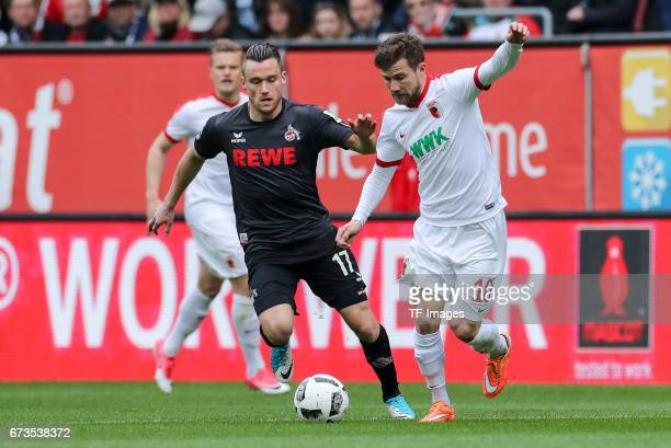 Christian Clemens of Colonge and Daniel Baier of Augsburg battle for the ball during the Bundesliga match between FC Augsburg and 1 FC Koeln at WWK...