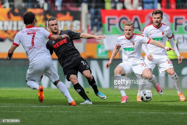 Christian Clemens of Colonge and Philipp Max of Augsburg battle for the ball during the Bundesliga match between FC Augsburg and 1 FC Koeln at WWK...