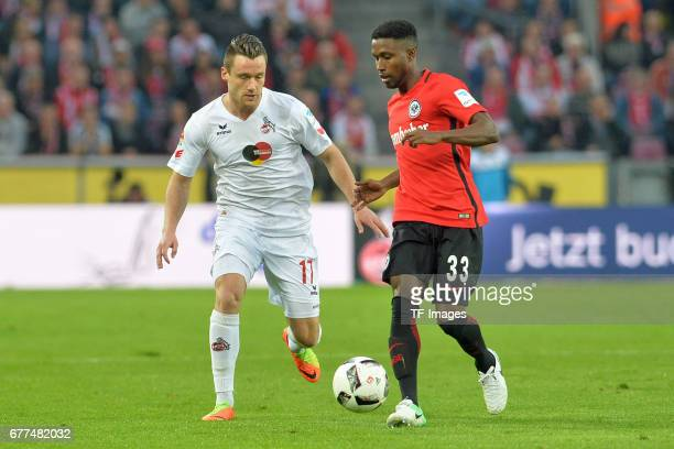 Christian Clemens of Colonge and Taleb Tawatha of Frankfurt battle for the ball during the Bundesliga match between 1 FC Koeln and Eintracht...