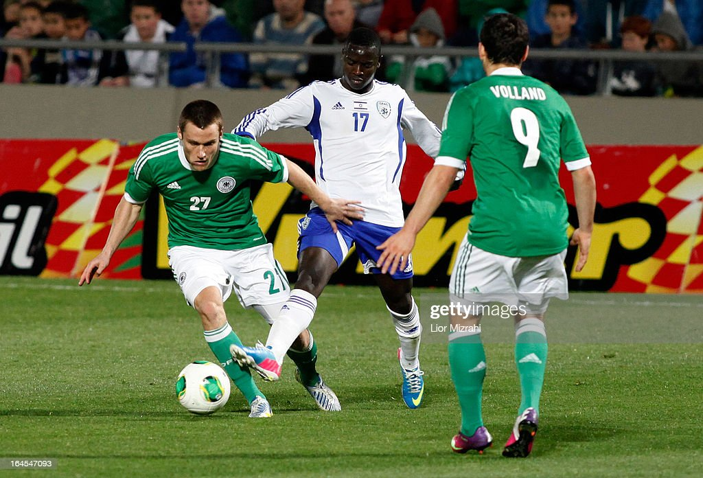 Christian Clemens of Germany challenges Sintayehu Sallalich of Israel during the Under 21 International Friendly match between Israel and Germany on March 24 2013 in Tel Aviv , Israel.