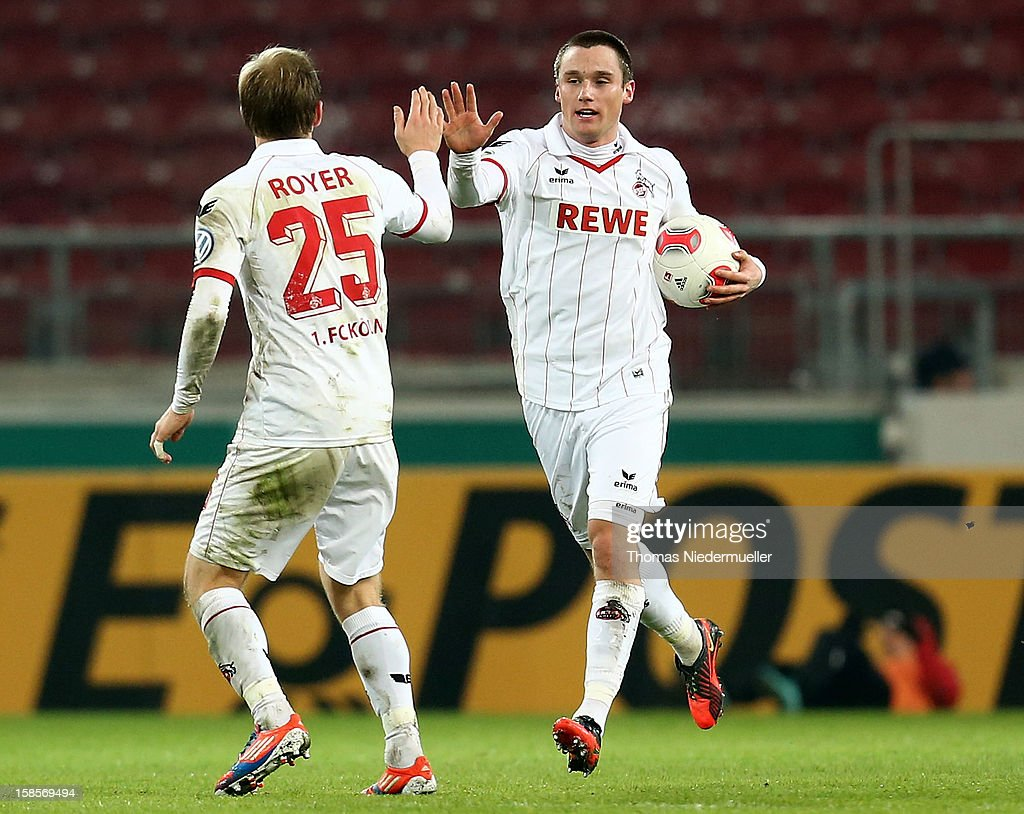 Christian Clemens (R) of Koeln celebrates his goal with Daniel Royer (L) during the DFB cup round of sixteen match between VfB Stuttgart and 1.FC Koeln at Mercedes-Benz Arena on December 19, 2012 in Stuttgart, Germany.